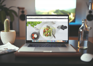 Laptop with Food website on it.
